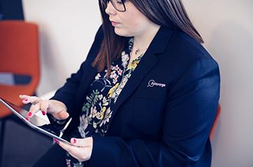 Woman holding an ipad.